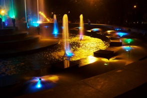 Highlighted fountain behind the Drama Theater
